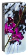 Purple Flowers In The Sky Portable Battery Charger