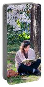 Reading Beneath The Cherry Blossoms Portable Battery Charger