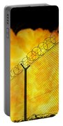 Realistic Orange Fire Explosion Behind Restricted Area Barbed Wire Fence, Blurred Background Portable Battery Charger