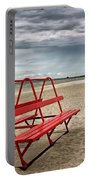 Red Bench On A Beach Portable Battery Charger