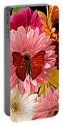 Red Butterfly On Bunch Of Flowers Portable Battery Charger