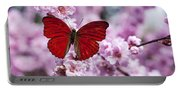 Red Butterfly On Plum  Blossom Branch Portable Battery Charger