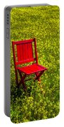 Red Chair Amoung Wildflowers Portable Battery Charger
