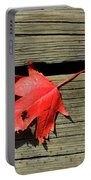Red Maple Leaf On A Boardwalk  Portable Battery Charger