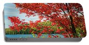 Red Maple On Lake Shore Portable Battery Charger