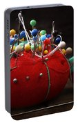 Red Pin Cushion Portable Battery Charger