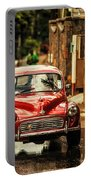 Red Retromobile. Morris Minor Portable Battery Charger