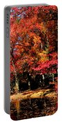 Red Trees By Lake Portable Battery Charger