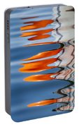 Water Reflection Of Orange Blobs And Black Zig Zagging Lines Portable Battery Charger