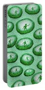 Reflection Of Waving Man In Water Droplets On Green Portable Battery Charger