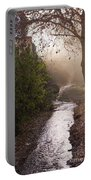 River In Afternoon Sunhaze  Portable Battery Charger