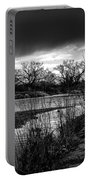 River With Dark Cloud In Black And White Portable Battery Charger
