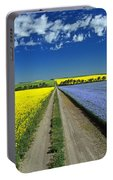 Road Through Flowering Flax And Canola Portable Battery Charger