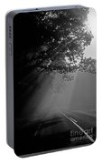 Road With Early Morning Fog Portable Battery Charger