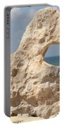 Rock With A Hole With A Tropical Ocean In The Background. Portable Battery Charger