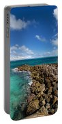 Rocky Shoreline On The Beach At Atlantis Resort Portable Battery Charger