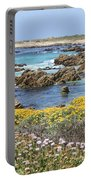 Rocky Surf With Wildflowers Portable Battery Charger
