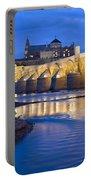 Roman Bridge On Guadalquivir River At Dawn Portable Battery Charger