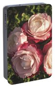 Roses In A Vase,on The Grass Portable Battery Charger