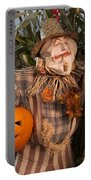 Scarecrow With A Carved Pumpkin  In A Corn Field Portable Battery Charger