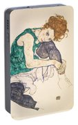 Seated Woman With Legs Drawn Up Portable Battery Charger