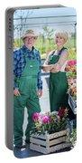 Senior Gardener And Middle-aged Gardener At Work. Portable Battery Charger
