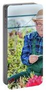 Senior Gardener Selecting A Tree. Portable Battery Charger