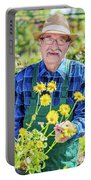 Senior Gardener Showing A Potted Flower. Portable Battery Charger