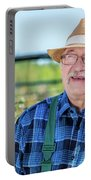 Senior Gardener Talking On The Phone With A Client. Portable Battery Charger