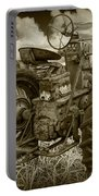 Sepia Toned Old Farmall Tractor In A Grassy Field Portable Battery Charger