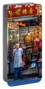 Shop Owner Standing In Front Of Poultry Shop On Temple Street Night Market Kowloon Hong Kong China Portable Battery Charger