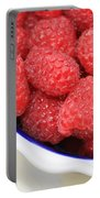 Side View Of Rasberries In Blue Bowl Portable Battery Charger