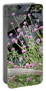 Sitting Amongst A Wildflower Garden Portable Battery Charger