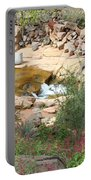 Slide Rock With Pink Wildflowers Portable Battery Charger
