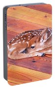 Small Deer Fawn Resting On Cedar Wood Deck Portable Battery Charger