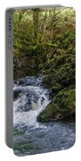 Small River Cascade Over Mossy Rocks In Northern Wales Portable Battery Charger