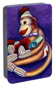Sock Monkey With Kazoo Portable Battery Charger