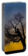 Solitary Tree At Sunset Portable Battery Charger