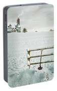 Spade Leaning Against Fence In The Snow Portable Battery Charger