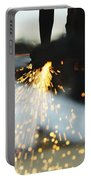 Sparks From Cutting Metal Portable Battery Charger