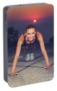 Sportive Woman Doing Pushups Outdoors Portable Battery Charger