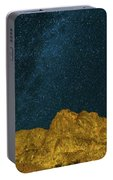 Starry Night Sky Over Rocky Landscape Portable Battery Charger