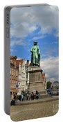 Statue Of Jan Van Eyck Beside The Spieglerei Canal In Bruges Portable Battery Charger