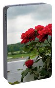 Stormy Roses Portable Battery Charger by Valeria Donaldson