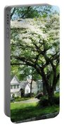 Street With Dogwood Portable Battery Charger