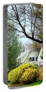 Street With Forsythia Portable Battery Charger
