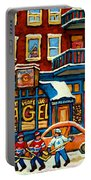 St.viateur Bagel Hockey Montreal Portable Battery Charger by Carole Spandau