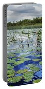 Summer Blue  Lake Under Clody Grey Sky With Forest On Coast Portable Battery Charger