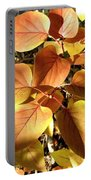 Sunlit Lilac Leaves Portable Battery Charger
