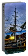 Sunset Over A Tall Ship Portable Battery Charger